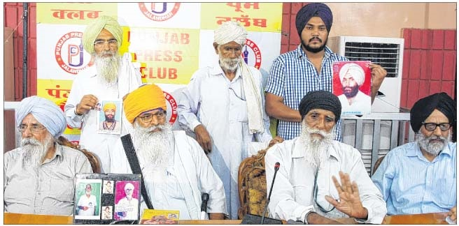 Advocate Amar Singh Chahal (sitting - right corner) and Journalist Dalbir Singh (sitting - left corner) with family members of victims of Fake encounters in Punjab. (Jalandhar - 14 July, 2013)