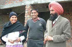 Comrade Balwinder Singh (R), his son Gagandeep and his wife Jagdish [File Photo]