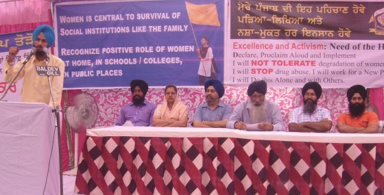 Youth activist Sukhvinder Singh addressing the conference. Seen in the pic are Kiranjot Kaur and others