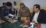 A police official takes the thumb print of a Pakistani Christian woman who has been sentenced to death for blasphemy
