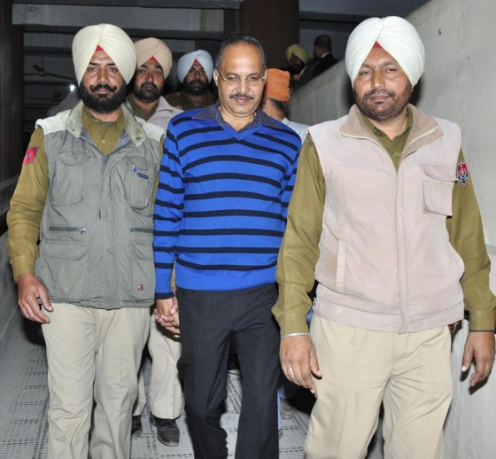 The police take away a police officer from Uttar Pardesh after he was held guilty by  a trial court on Monday in a fake encounter case on Monday.