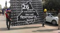 """Sikh youth activists carry a display board terms 26 January as """"Betrayal Day"""""""