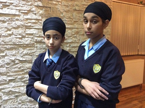 Simranjot Kaur, 13, (right) and 11-year-old Prasimran Kaur, (left) who aren't related, returned to St Anne's Catholic School in Southampton, Hampshire, wearing dastars | Source Daily Mail