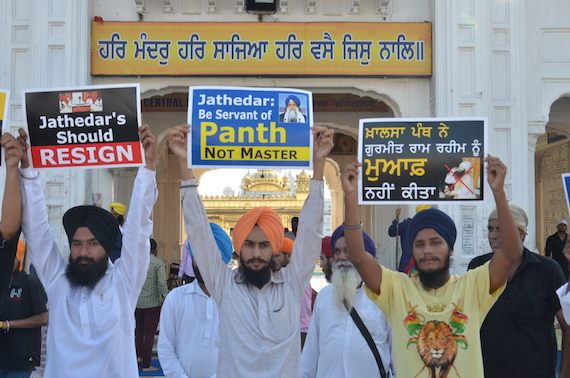 Sikh youth activists holding placards during the demonstration