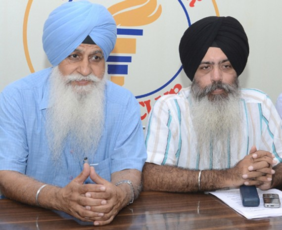 HS Dhami and Kanwarpal Singh talking to mediapersons