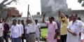 Shiv Sena leaders firing in the air during cremation of slain leader Durga Prasad Gupta as tribute in Khanna