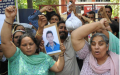 Jagdeep Singh's mother (left), along with other family members and villagers, protest against the police outside the Sohana police station in Mohali on April 26