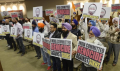 Members of the Sikh community hold up signs denouncing the mass killing of Sikh people in India in 1984, following a vote by the Kerman city council to formally acknowledge the violence as a genocide. CRAIG KOHLRUSS