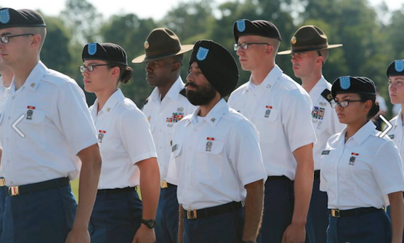 Army Specialist Harpal Singh stands with other soldiers receiving awards at the Basic Combat Training Graduation for 3RD Battalion, 60th Infantry Regiment at the U.S. Army Training Center at Fort Jackson in Columbia, SC.