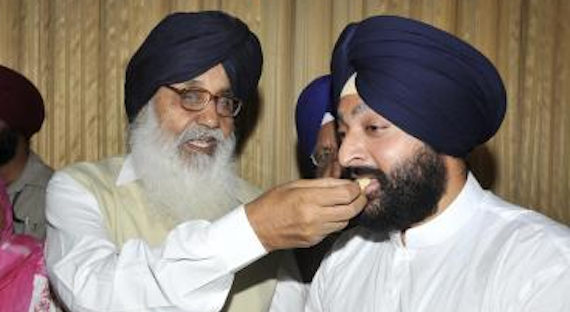 Punjab Chief Minister Mr. Parkash Singh Badal offer sweets to new elected MLA from Amritsar South Mr. Inderbir singh Bolaria after his swearing ceremony at Punjab Assembly on 29 May 2008 [File Photo]