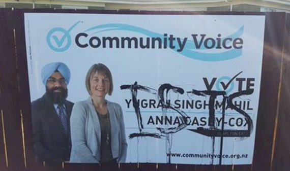 The billboard showing Yugraj Singh Mahil and another candidate Anna Casey-Cox which was defaced and has now been removed