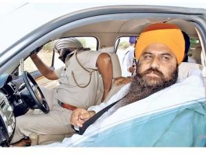 Baba Baljeet Singh Daduwal in police custody [File Photo]