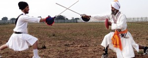 Gatka instructor Avtar Singh (R) and another demonstrating gatka at Punjab University Patiala sports ground [File Photo]