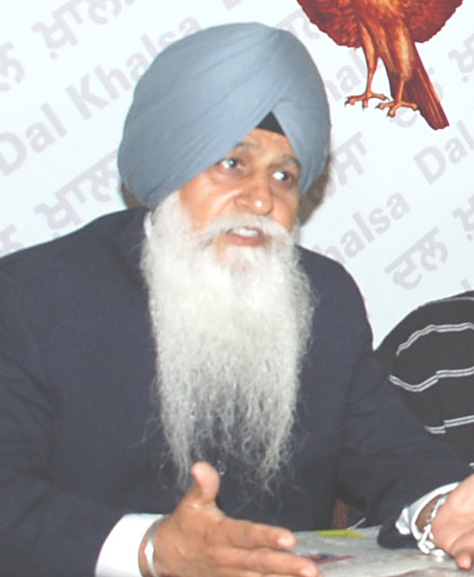 HS Dhami talking to the media