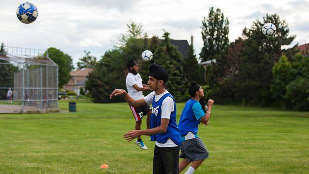 Sikh children playing soccer