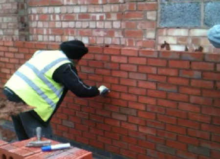 A Sikh worker doing brickwork on a construction site in Leicester (UK) [File photo]