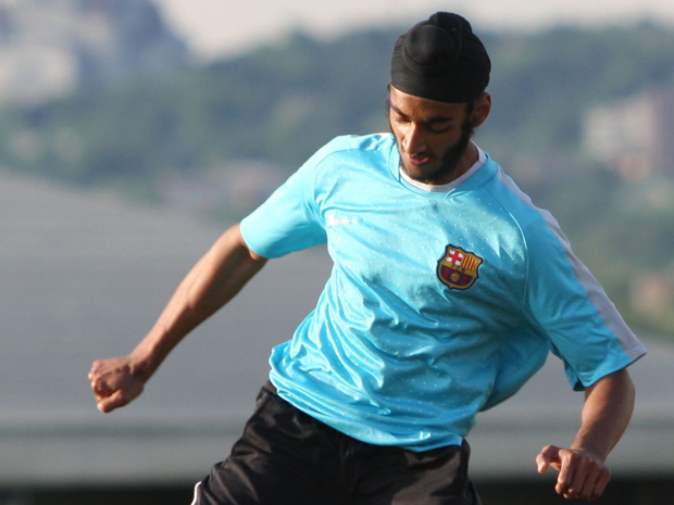Dilpreet Singh plays in a pick-up soccer game in Montreal. The Quebec Soccer Federation has lifted its ban on the wearing of turbans in organized games.